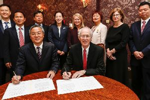 Councillor Peter Box and Mayor Zhou Hongbo sign the friendship agreement on Thursday morning.