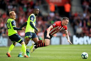 Southampton's Pierre-Emile Hojbjerg is fouled by Huddersfield Town's goalscorer Alex Pritchard, left, during the 1-1 draw at St Mary's Stadium (Picture: Adam Davy/PA Wire).