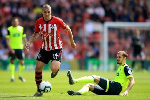 Southampton's Oriol Romeu gets away from Huddersfield Town's Jon Gorenic Stankovic at St Mary's Stadium. Picture: Adam Davy/PA