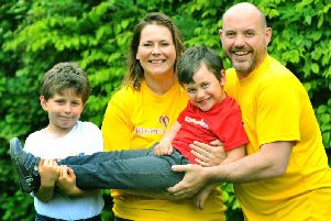 The Mitchell family, from left to right: Gabriel, seven, mum Emma, Sam, four, and Dad Alistair at their home in Colton, Leeds.