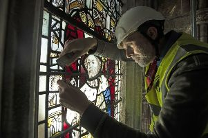 Conservation Manager Nick Teed removes a stained glass window during the first phase of work to protect 600-year-old stained glass windows, part of an 11 year, ??11m conservation and restoration project at York Minster.