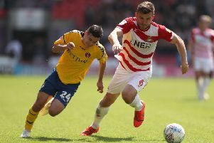 Wembley target: Charlton Athletic's Josh Cullen, left, and Doncaster Rovers' Andy Butler battle for the ball at the Keepmoat Stadium.