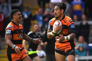 Castleford Tigers' Jesse Sene-Lefao, right, celebrates a try with team-mate Peter Mata'utia as they eased to a 30-8 Super League victory at Leeds Rhinos ('Picture: Jonathan Gawthorpe).