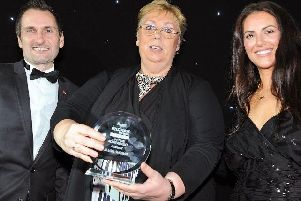 Jillian Thomas with her Lifetime Achievement Award, presented by Derbyshire Times editor, Phil Bramley, and former Apprentice star Jessica Cunningham.