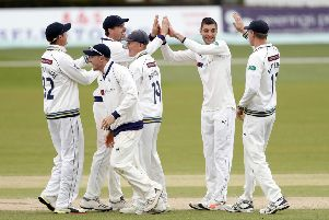 Duanne Olivier (2nd R) of Yorkshire is congratulated by team mates after he took the wicket of Fred Klaassen.