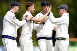 Ben Coad is congratulated by his team-mates after taking the wicket of Ollie Robinson. Picture: Max Flego.