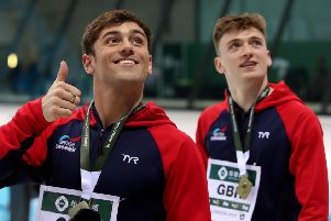 DYNAMIC DUO: Leeds' Matty Lee and Tom Daley celebrate their win in the Diving World Series at London Aquatics Centre. Picture: Bradley Collyer/PA