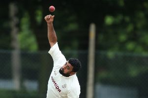 Woodlands spinner Kez Ahmed in action durig his side's Bradford Premier League victory away to Townville last Saturday which maintained their unbeaten start to the season. Picture: John Cliton.