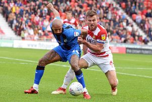 Doncaster Rovers' defender Andy Butler, right, in action against Gillingham (Picture: Marie Caley).