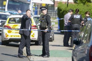 Police officers in Shiregreen following the deaths of two children in Sheffield earlier today