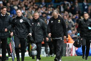 Chris Wilder and Marcelo Bielsa leave the pitch at half time during their Championship encounter at Elland Road in March.  Picture: Bruce Rollinson