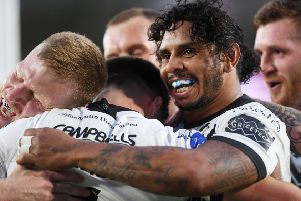 Hull's players celebrate Jamie Shaul's try in their Challenge Cup win over Catalans Dragons.