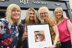 Ailsa is pictured with mum Joanne Hodge (left), Rachel Taylor (second from right) owner of RJT Solicitors, Standish, and solicitor Donna Gamble, competition organisers