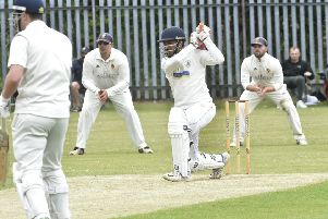Sashin Jayawardana hits four runs on his way to making 81 for Barkisland. However, an unbeaten 99 from Jonathan Booth took Townville to victory in the Heavy Woollen Cup (Picture: Steve Riding).