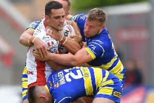 New contract: Hull KR's Craig Hall, tackled during the Super League match against Warrington, is staying with Robins. Picture: Dave Howarth/PA