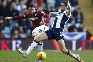 Tommy Elphick, who has signed for Huddersfield Town, seen left challenging West Bromwich Albion's Jay Rodriguez while playing for Aston Villa (Picture: Darren Staples/PA Wire).
