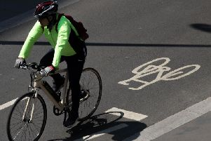 A cyclist using a designated cycle lane