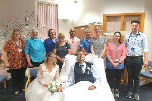 Jo and Nick Glover with Wigan Infirmary staff