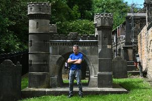 Filmmaker Mark Currie at the memorial to the railway navvies killed during the construction of the Bramhope Tunnel, in the grounds of Otley Parish Church.''Picture by Jonathan Gawthorpe