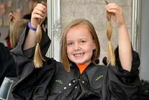 Amelia Gomm, eight had her hair cut for the Little Princess Trust and raised over �2,000 for Myeloma UK