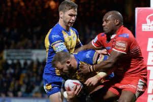 Robert Lui tries to prevent Leeds Rhinos' Adam Cuthbertson touching down as Matt Parcell looks on. Picture Bruce Rollinson