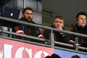 Grant McCann and Paul Gerrard watch from the stands.