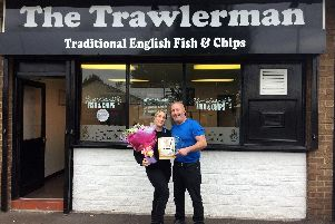 Steve Westhead and partner Vicky Booth outside their award-winning chip shop
