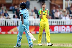 Australia's Jason Behrendorff celebrates taking the wicket of England's Jofra Archer (left), caught by David Warner at Lord's. Picture: Tim Goode/PA