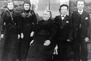 Tragedy: Mrs Harriet Wood, who lost husband William and two sons John and Friend in the disaster. She is pictured some years later with her four remaining children. She had to send another son, Harry, pictured next to her, down the pit when he was only 12. Her other children were Mary Ellen, pictured far left, and Emma and Gladstone.