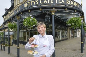 A waitress outside Bettys in Harrogate. picture mike cowling jun 16 2015