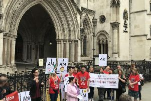 Campaigners gathered outside the Royal Courts of Justice ahead of the landmark legal challenge against the Government over special educational needs funding. Picture by Sian Harrison/PA Wire.