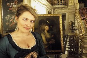 Samantha Clarke as Georgiana in Chatsworth with the portrait of the Duchess she plays.