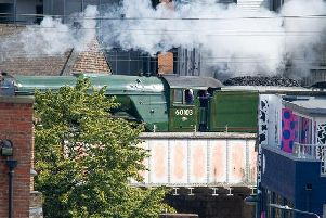 The Flying Scotsman flies through Leeds city centre on its journey from York to Carlisle on Sunday morning. As seen from Brewery Wharf. Picture: Bob Peters