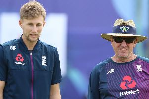England's Joe Root (left) and head coach Trevor Bayliss. Picture: Nigel French/PA