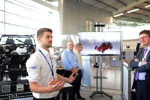 Greg Clark, Secretary of state for Business, Energy and Industrial Strategy, with James Lindsey, project engineer. Picture: Marie Caley NSST-08-07-19-AMRC-4