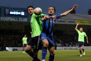 Cardiff City's Sean Morrison (left) and Gillingham's Tom Eaves battle for the ball.
