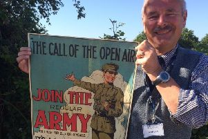 Adrian Stevenson with one of the 1919 posters. Photo by Hansons.