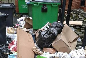 Opposition councillors claim that charges for disposing building materials have caused an increase in fly tipping.