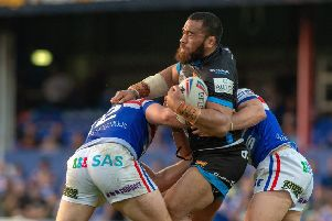 Huddersfield's Suaia Matagi is held by Wakefield's Jacob Miller and George King. Picture Bruce Rollinson