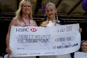 Retiring Carnival queen Carys Burnett presents the 5,000 cheque to Michelle Lonican from Trinity Hospice