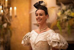 Suranne Jones as Anne Lister wears a white gown to the Queen of Denmark's birthday ball in the final episode of Gentleman Jack. Picture: BBC/Lookout Point/HBO/James Stack.