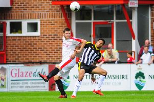 Matt Baker (left) tussles against Notts County on Saturday.