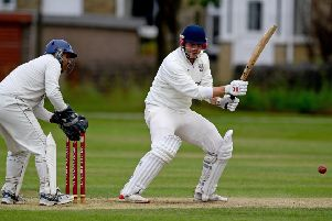 Woodlands captain Cieran Garner hit the winning runs as his side overcame Hanging Heaton to reach a third Priestley Cup final in four years,