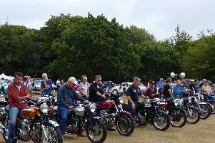 A line up of motorcycle enthusiasts.