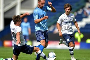 Ben Davies makes a tackle when PNE met Newcastle United  in a friendly in July 2017