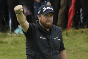Ireland's Shane Lowry celebrates after his birdie at the 10th hole during the second round of the British Open Golf Championships at Royal Portrush today.