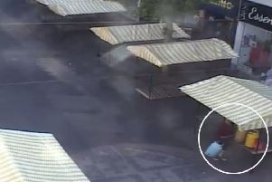 CCTV footage shows market trader Paul Marshall dumping four gas bottles by a stall on Worksop Market.