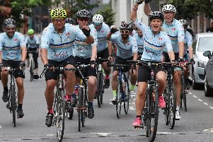 Sister of murdered MP Jo Cox, Kim Leadbeater (second right) leads bike riders into Flat Iron Square in London for the charity ride in memory of Jo.