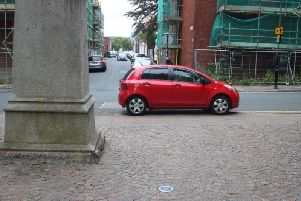 The security staff car parked on double yellow lines next to Sir Robert Peel's statue in Winckley Square.