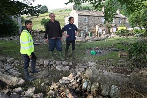 Richmond MP Rishi Sunak surveys the damage at a flood-hit farm in the Yorkshire Dales. Picture courtesy of the National Farmers' Union.
